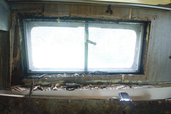 1969 Dodge Travco water damage kitchen window photographed by luxagraf