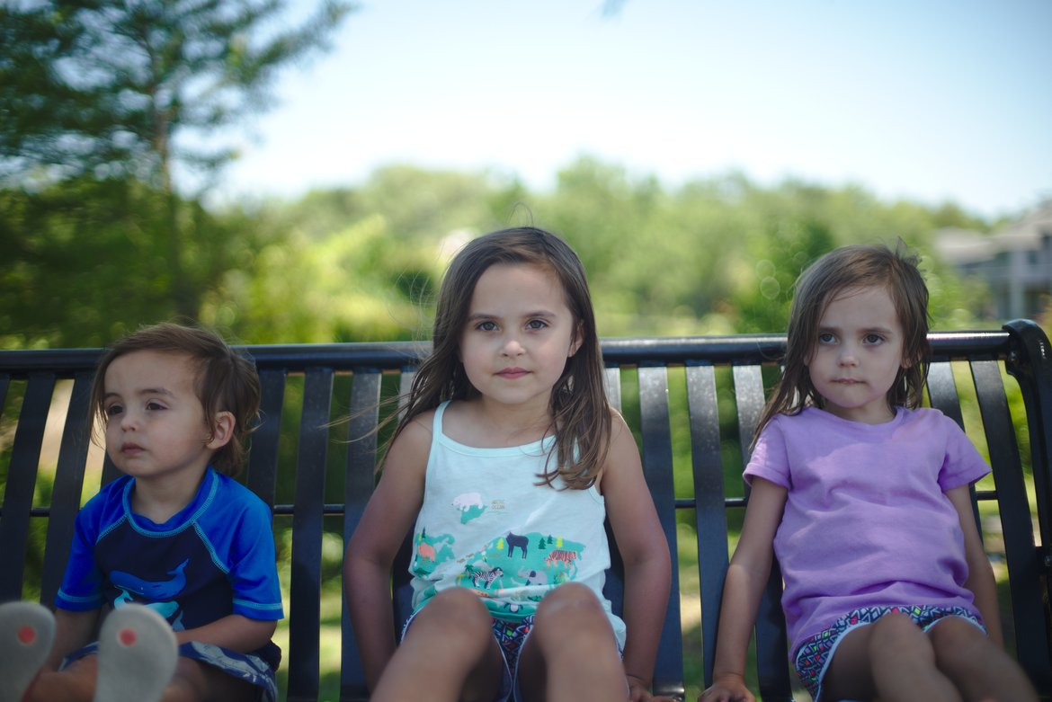 kids on a bench, ocean springs, ms photographed by luxagraf