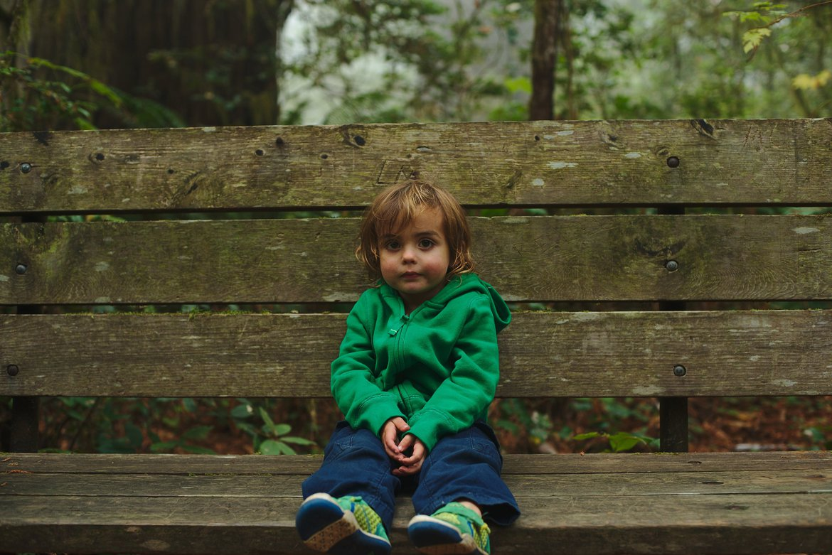 kid on a bench, redwods photographed by luxagraf