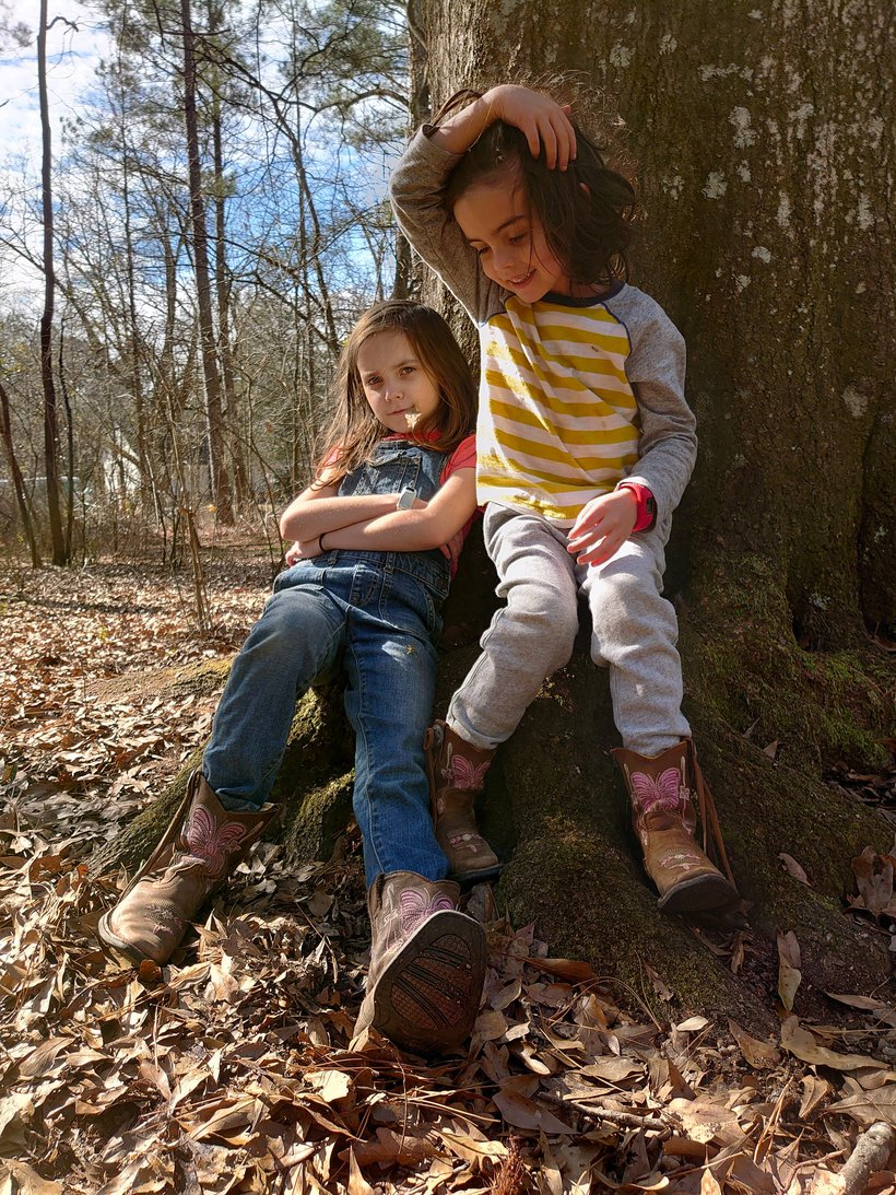 kids sitting on tree roots photographed by luxagraf